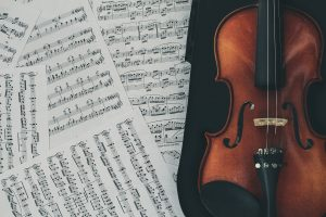 sheet music and a violin